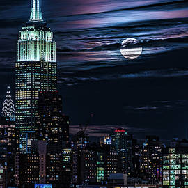Blue Moon Rising Over Manhattan by Chris Lord