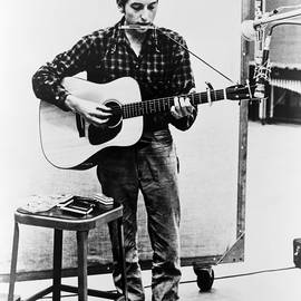 Bob Dylan B. 1941 Playing Guitar by Everett