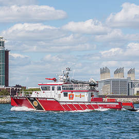 Boston Fire Rescue Boat Passing Logan Airport by Brian MacLean