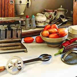 Susan Savad - Bowl of Tomatoes on Counter