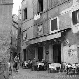 Boy on a bicycle on a street in Rome, 1955 - The Harrington Collection