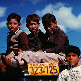 Boys Sitting On Truck Parked At The Fsa by Celestial Images