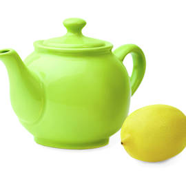 Yurii Agibalov - Bright green  teapot and lemon on  white background.