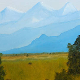 Canadian Rockies In The Distance Beyond The Farmed Flatlands by Rod Jellison