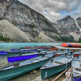 Canoes On Moraine Lake  by Paul Quinn