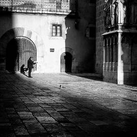 Catching up on the News in Tarragona Spain BW by Joan Carroll