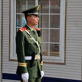 Imran Ahmed - Chinese policeman smartly stands guard in Beijing China