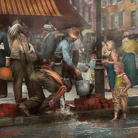 Mike Savad - City - NY - Drinking water from a street pump 1910