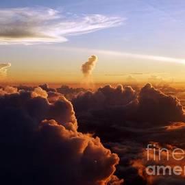 Barbie Corbett-Newmin - Cloud Canyons at Sunrise