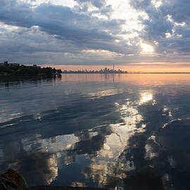 Clouds and Clouds and Toronto Skyline at Sunrise by Georgia Mizuleva