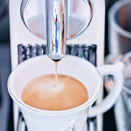 Oksana Ariskina - Coffee Machine pouring hot Espresso coffee into a cup