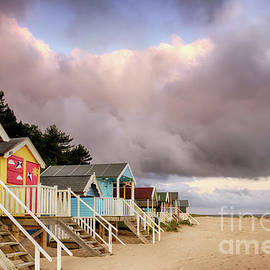 Simon Bratt Photography LRPS - Colourful beach huts on golden sand coast
