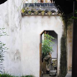 Mark and Yuk Mei Bjorndal - Courtyard Entrance