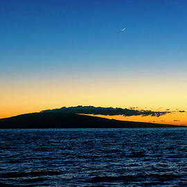 Crescent Moon Sunset by Jim Thompson