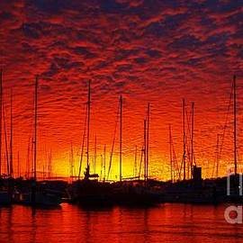 Crimson Nautical Sunset. by Geoff Childs
