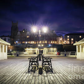 Cromer pier at night in Norfolk England by Simon Bratt Photography LRPS