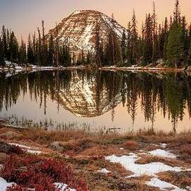 Dawn reflection in the Uinta Mountains. by Johnny Adolphson