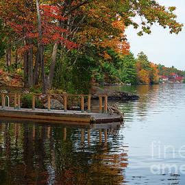 Les Palenik - Dock on lake in fall