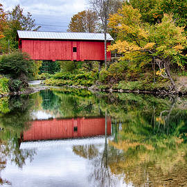 Jeff Folger - Early fall colors surround a covered bridge in Vermont