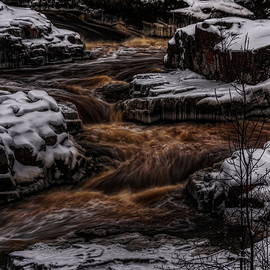 Dale Kauzlaric - Eau Claire River Through Snow Covered Rock