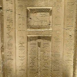 Egyptian hieroglyphics on stone door