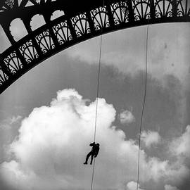 Eiffel Tower and a man on rope. by Cyril Jayant