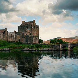 Eilean Donan Castle On A Cloudy Day by Jaroslaw Blaminsky