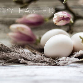 Elegant Happy Easter card with eggs and magnolia on the wooden background by Aldona Pivoriene