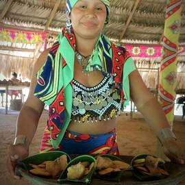 Embera Indian lady serving a meal