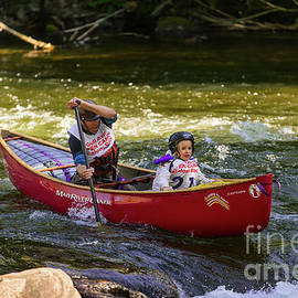 Father And Daughter In A Whitewater Slalom Race by Les Palenik