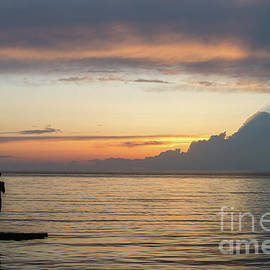 Fishing at sunset on Lake Erie by Paul Quinn