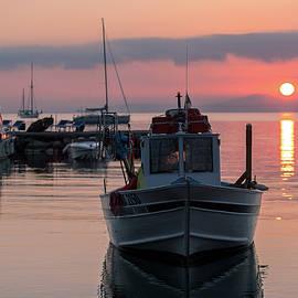Andrey Bo -  Fishing boat at sunrise.