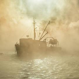 Edward Muennich - Fishing boat enveloped in sea smoke