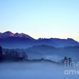 Fog Creeps Up The Valley - Switzerland by Susanne Van Hulst