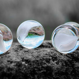 Four Marbles by Jim Love