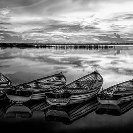 Four Old Boats Side by Side in Black and White by Debra and Dave Vanderlaan