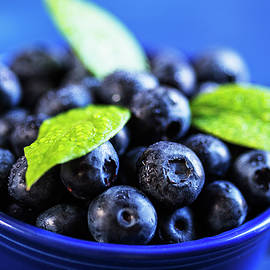 Vishwanath Bhat - Fresh blueberries in a blue bowl