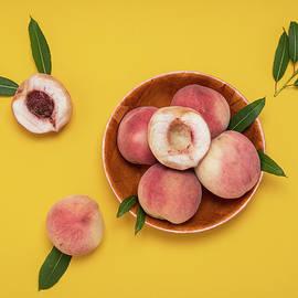 Sergei Dolgov - Fresh juicy peaches and green leaves