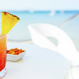 Radu Bercan - Fresh Red And Orange Cocktail Glass In Summer With Ocean Background