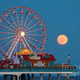 Silvio Ligutti - Full Moon rising above the Gulf of Mexico - Historic Pleasure Pier - Galveston Island Texas