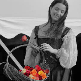 Girl selling roses selective color by David Freuthal