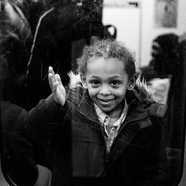 Girl Subway Window by Dave Beckerman