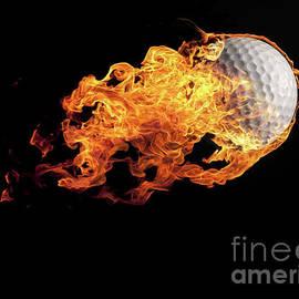 Andreas Berheide - Golf ball with flames on black