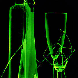 Green wine glasses and a bottle