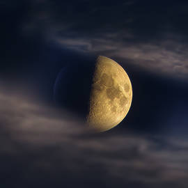 Half Moon Seen Through Night Clouds by Alexey Kljatov