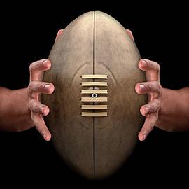 Hands Gripping Rugby Ball - Allan Swart