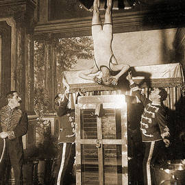 Harry Houdini suspended above a tank of water  - American School