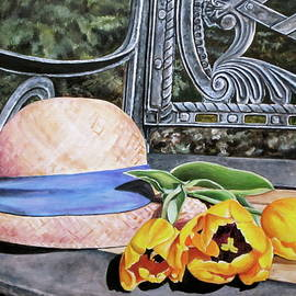 Hat on garden bench with tulips by Lillian  Bell
