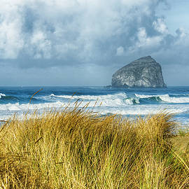 Haystack Rock during a storm from Bob Straub State Park, Pacific by John Trax