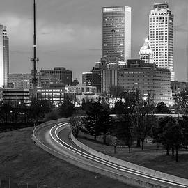Gregory Ballos - Highway View of the Tulsa Skyline at Dusk - Black and White